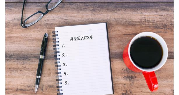 Image of an agenda and coffee